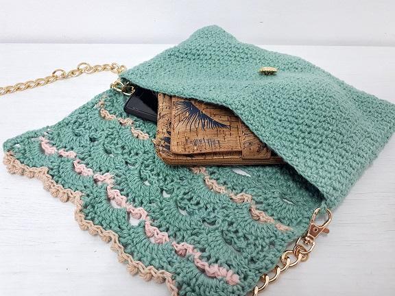 pearls of the sea crochet clutch bag